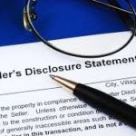 Sellers property disclosure document with a pen laying on top