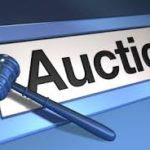 auction with gavel symbol on computer screen
